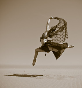 Katie Ponozzo, dancer at the Bruneau Sand Dunes in Idaho. Photo by Mike Reid, All Outdoor Photography.