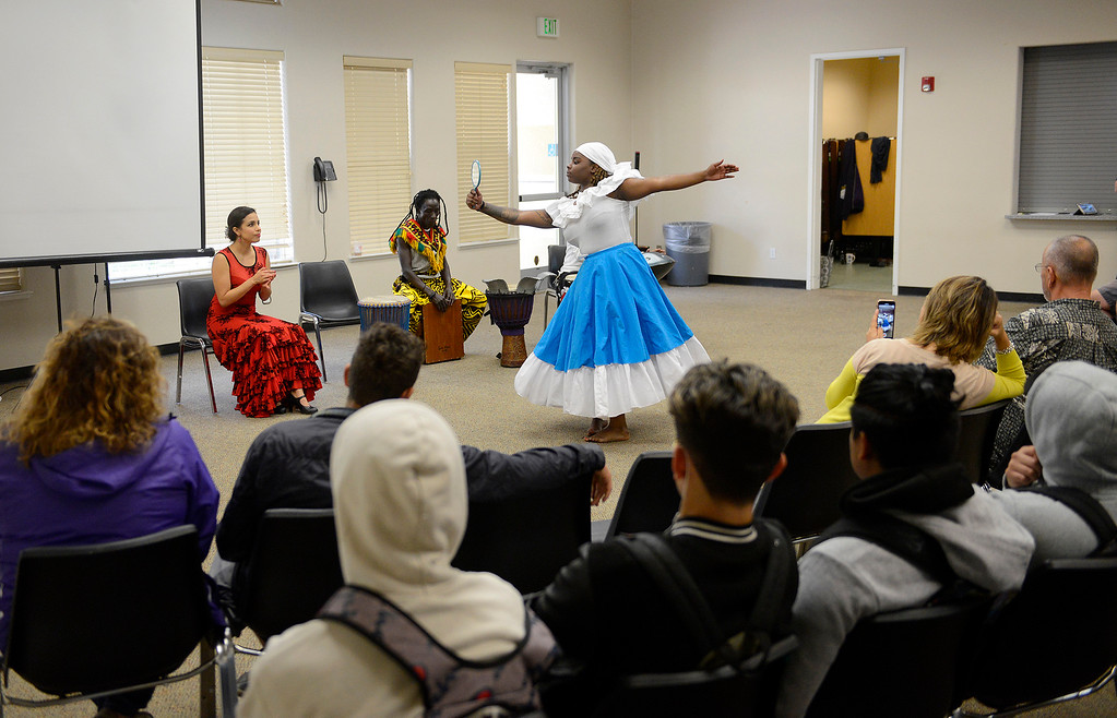 . Ebonie Barnett performs a Haitian Folkloric dance with the Dancing Souls, Global Dance Rhythms performace for Central Coast High School students in Seaside on Wednesday, September 19, 2018.  (Vern Fisher - Monterey Herald)
