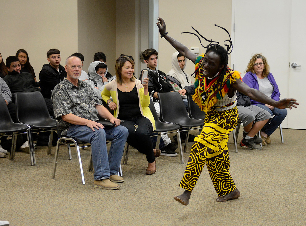 . Mohamed Bangoura performs a West African dance with the Dancing Souls, Global Dance Rhythms performace for Central Coast High School students in Seaside on Wednesday, September 19, 2018.  (Vern Fisher - Monterey Herald)