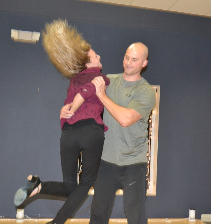 """. Danielle Watko, professional dancer and instructor at the Rochester Ballroom, rehearses with Stephen Kramer, a sergeant with the Oakland County Sheriff\'s Office and a contestant in a local version of \""""Dancing with the Stars.\"""" Anne Runkle/The Oakland Press"""