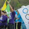 John Strickler - Digital First Media<br /> Daniel Boone student cheers as the Special Olympic games open at the high school stadium Monday. Brunner  took first place in the 100 meter race he competed in and had the honor of carrying the Olympic rings flag.