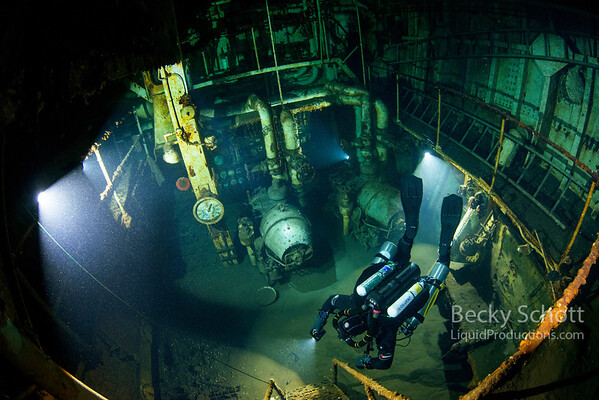 Unique underwater shot of the Daniel J. Morrell ship inside the Engine Room with a rebreather diver