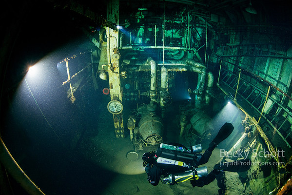 Exploring a section of the engine room on rebreathers