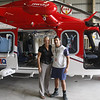 Danielle & Patrick Martin (Rescue Crew Officer) in front of the EMQ rescue chopper that rescued Ally & Rich.