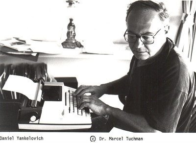 Undated DY at Typewriter by Marcel Tuchman.jpg