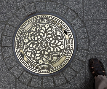 Manhole cover on the walking street.