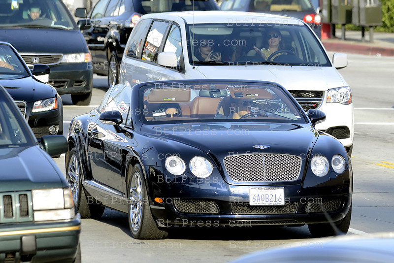 Exclusive__ Dany Boon is driving his new $ 250.000 Bentley convetible in Hollywood with his wife.