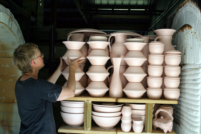 Unloading bisque from 45 cubic foot propane fired car kiln.  Cone 12 reduction glaze firing is also done in this kiln.