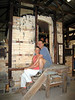 Gary & Daphne Hatcher on the steps of their 120 cubic foot Bourry Box wood fired kiln.  Fired to Cone 12 in reduction, the firing requires about 3 cords of mixed hardwoods.  The kiln is stoked every five to ten minutes for 24 hours.  It then takes 2-3 days to cool before it can be opened.