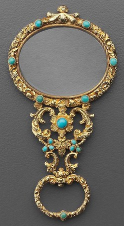 Quizzing glass of gold and turquoise.