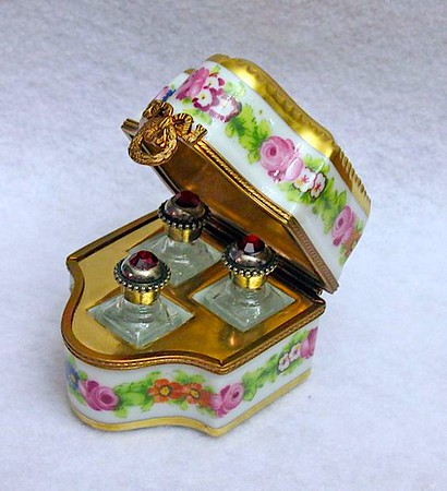 French Limoges scents in an enameled floral chest.