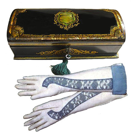 Beautiful gloves and a lacquered glove box.