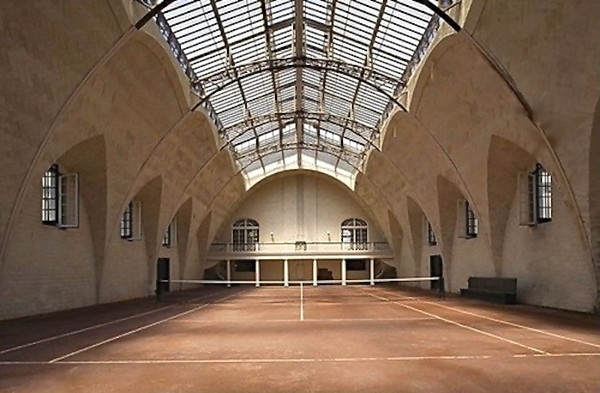 The Pemberley indoor tennis court and game room with ...