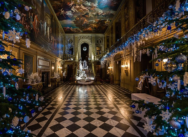 Pemberley foyer decorated in blue-themed Christmas