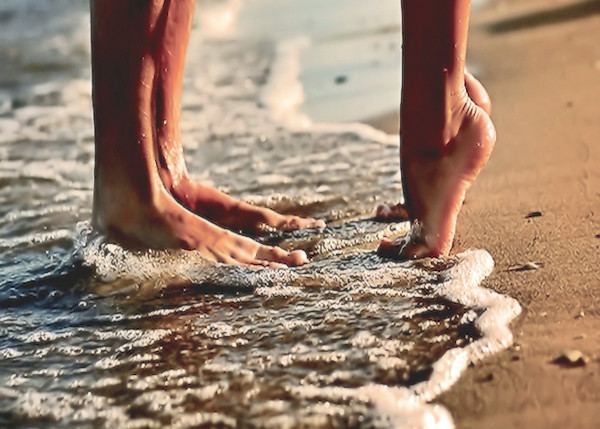 walking on the sand and surf