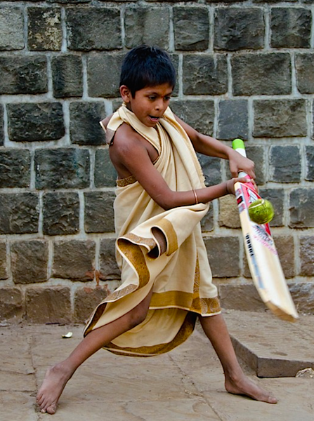 Indian boy playing cricket