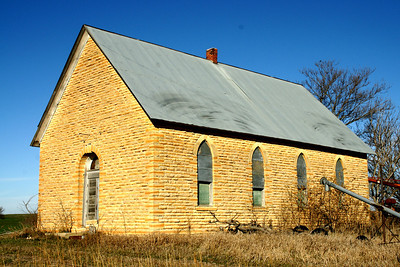Abandoned limestone school in southeast Jewell County