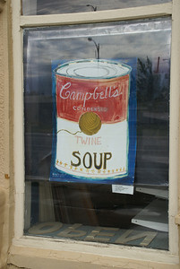 Twine art in window of downtown building in Cawker City. Campbell's Soup can.