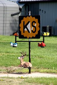 Homemade Kansas state line sign at Harbine, Republic County, Kansas