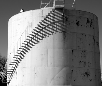 Oil Storage tank in Greenleaf - note shadow of stairs. Converted to black and white.