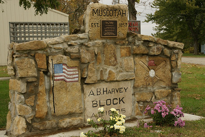 Muscotah town sign in park. Has memorial to baseball player Joe Tinker