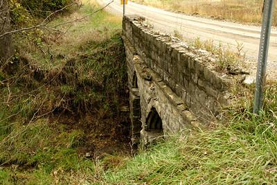 Limestone bridge with steel culverts in northwest Atchison County