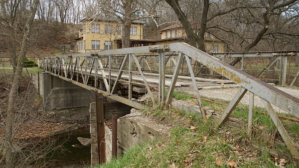 Truss footbridge and Hotel at Sycamore Springs