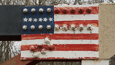 Flag art on Pony Truss bridge over South Fork Wolf River
