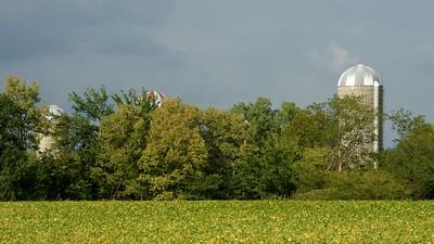 Three silos on farmstead - southern Douglas County