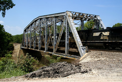 BNSF train crossing iron truss bridge over Marais De Cygnes River near Pomona