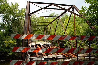 Abandoned iron truss bridge over Tauy Creek northeast of Ottawa