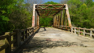 Closed iron truss bridge over Delaware River east of Valley Falls