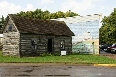 Holm log cabin and early town mural in Blue Rapids