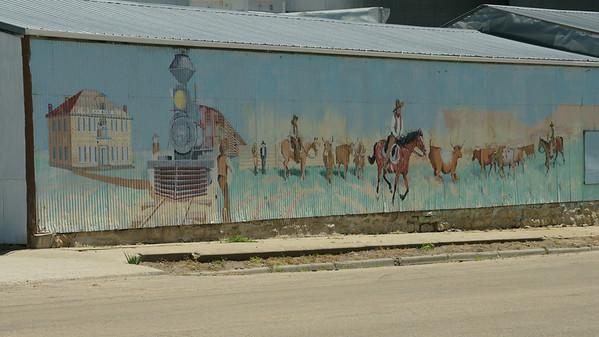 Early town scene mural in Waterville