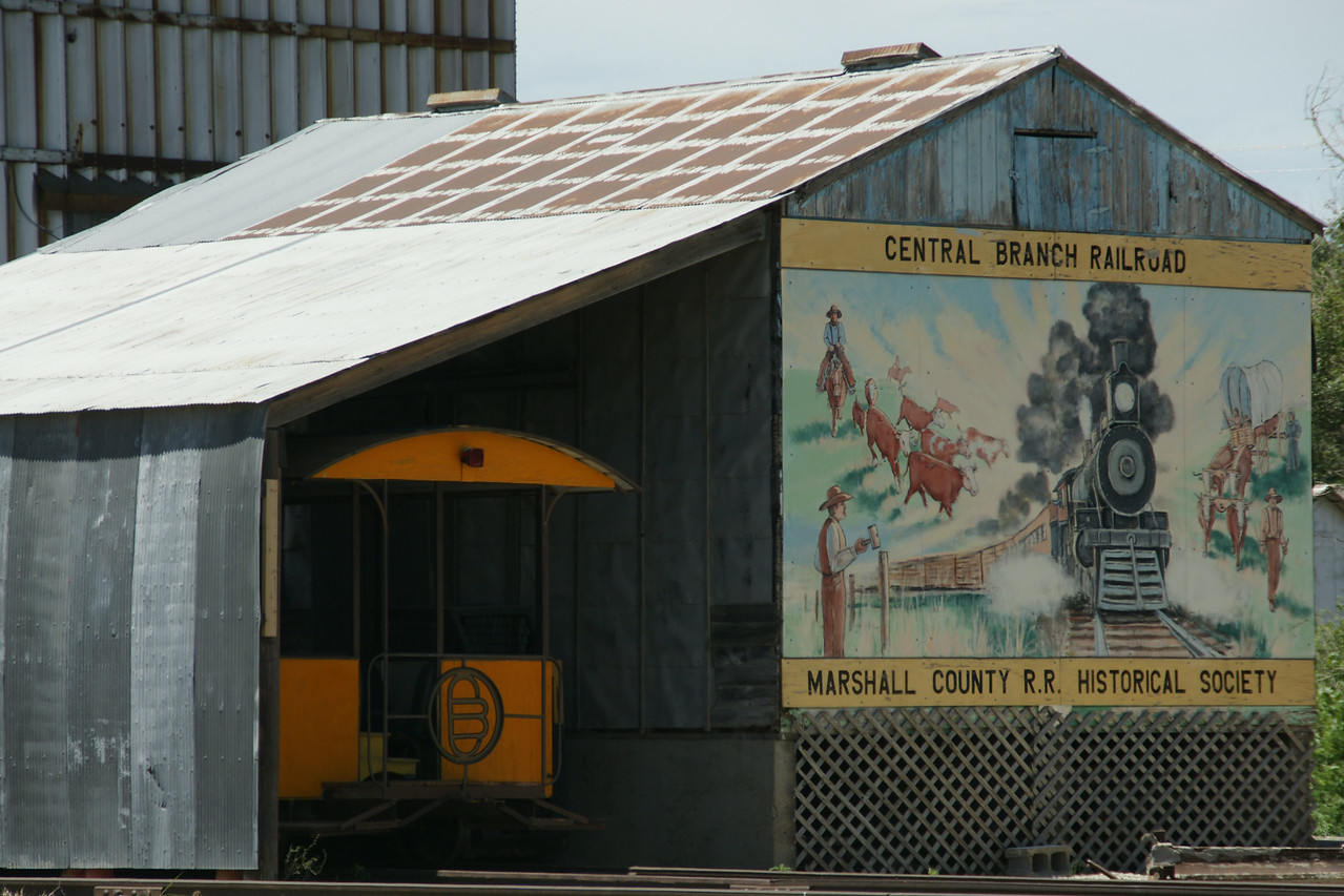 Central Branch railroad equipment and mural in Waterville