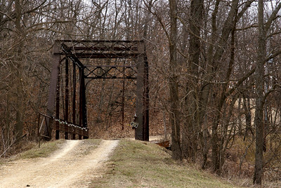 Iron Truss bridge over North Wea Creek west of Louisburg. On a private road.