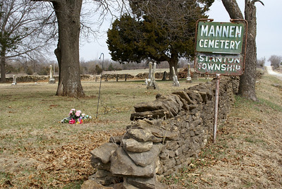Mannen Cemetery west of Paola. Limestone fence surrounds cemetery