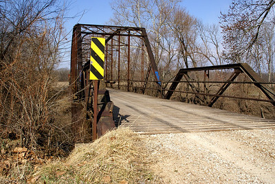 Carey's Ford iron truss bridge over Marais Des Cygnes River northwest of Osawatomie. Built in 1909.