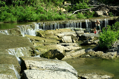Deep Creek waterfall at Pillsbury Crossing. People playing in water