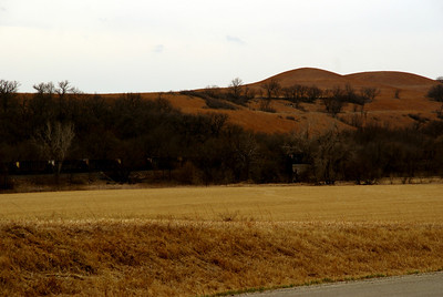 Hills and parked railroad cars along West Branch Mill Creek near Volland