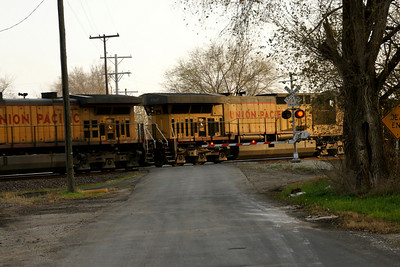 UP train passing over 142nd Street near Loring Drive