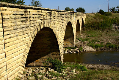 Four arch masonry stone bridge over Big Creek south of Walker