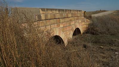 Pink limestone arch bridge