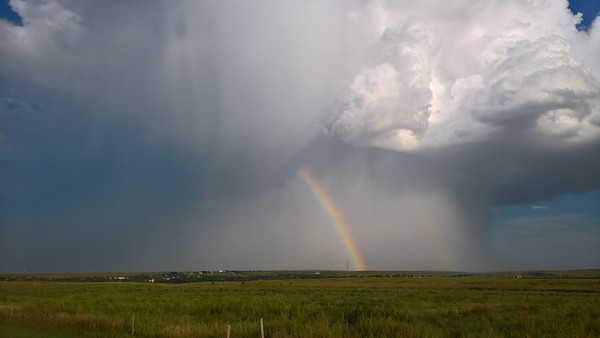 Thunderstorm with rainbow seen over Atwood