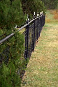 Elegant fence at Schoenfeld Cemetery - northwest Barton County
