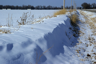 Snow drifts along RD 21 - western Cowley County