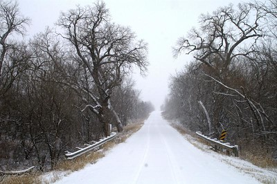 Snowy road in eastern Harvey County