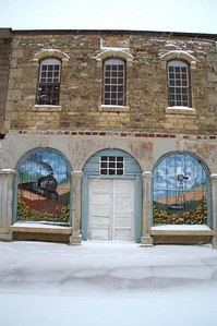 Murals on building in Walton - eastern Harvey County