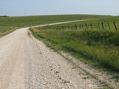 Rounding a curve in the Flint Hills on Yarrow Rd in eastern Marion County