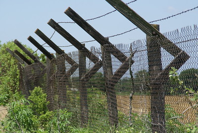Wood security fence remnants around former Hutchinson Air Base near Yoder